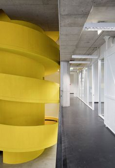 Baukuh's House of Memory features a monumental yellow staircase.