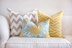 I want these colors for my living room chevron + blue + yellow geometric cushion on white sofa