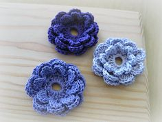 Crochet Flower Accent pattern by Mimi Alelis. Attach this flower accent onto a button on your clothes or accessories. The center hole is oval-shaped so the flower doesn't easily slip off the button.