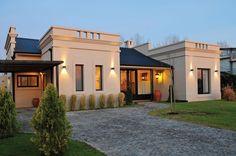 Marcela Parrado Arquitectura - Casa estilo Clásico Campo Argentino - Arquitecto