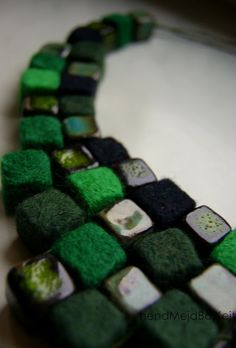 Felt blocks and cubed beads in a necklace