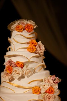 Gold and orange flowers on this Curtis Center cake - Photo by Phil Kramer Photography