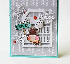 Card by Amy Rohl. Reverse Confetti stamp set: Merry Christmoose. Confetti Cuts: Merry Christmas, Snowflake Trio and Holly Jolly Tag. RC Cardstock: Iced Aqua and Cloud White. RC 6x6 paper pad: Very Merry. Christmas card. Winter card. Holiday card.