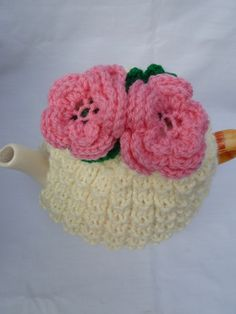 hand knitted rose tea cosy cream base and pink  by TWINKKNITS, £13.00