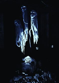 Halloween inexpensive prop inspiration!!! Masks, cheesecloth, uplighting. How cool is that. HF member haunt photo.