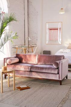 Urban Outfitters blush pink velvet sofa