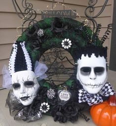 This Happy Couple is creating sparks of their own. Both Frankensteins Monster and Bride of Frankenstein take centre stage while the battery operated lights overhead twinkle the electric charge between them. Wreath measures 22 inches. Free Pick-up or Delivery in Edmonton, AB.