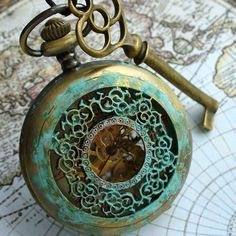 Old Pocket Watch and Key _ Artistically, patina is that enchanting green that illustrates the Passage of Time and imparts an historic character.