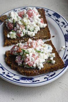 Cottage cheese, chopped chives, diced tomato, cucumber, salt & pepper to taste. Then pile it all on top of a couple of slices of hearty rye bread and enjoy!