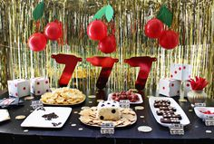 Game themed food! Domino brownies, dice cheese ball, ace playing card bean dip. Slot machine cherries and grapes.