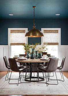 Using this deep blue jewel tone on both the ceiling and the walls really helped to define the dining room. I love the way the color is contrasted against the clean, white wainscoting and trim. Kitchen and dining room paint color option Dining Room Blue, Dining Room Colors, Dining Room Walls, Dining Room Design, Dining Room Furniture, Copper Dining Room, Furniture Ideas, Industrial Dining, Colorful Dining Rooms