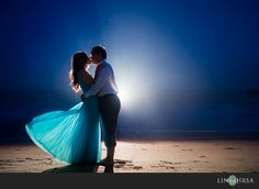 love the lighting, deep blue of the sky contrasting the sand, silhouettes, and her blue dress