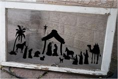Great idea for a Christmas nativity. I love that they put it on an old window. That way you can switch it out for each holiday!