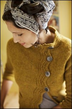 LOVE her sweater! Pretty for fall