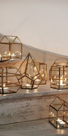 Mixture of candles and plants on window sill Create a unique miniature world, candle display feature or living art with our Gold & Glass Mini Glass House Terrarium, an ornamental piece combining brass, glass and mirror in a quirky glass house design.