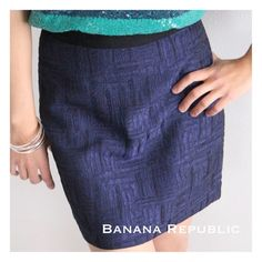 """(Sz 2) Banana Republic Textured Navy Blue Mini (Sz 2) Navy mini, high sheen, with a black waistband. Gorgeous horizontal/vertical pattern adds texture.  This A-line skirt is in excellent, like new condition. ▪️17"""" Length, 29"""" Waist, 36"""" Hips ▪️Shell: 76% Polyester, 24% Rayon; Lining: 100% Acetate ▪️Machine wash cold, tumble dry, or dry clean. Banana Republic Skirts Mini"""