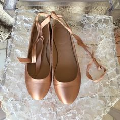 Pink satin ballet flats with grosgrain strap Pink satin ballet flats with grosgrain strap from JCrew. J. Crew Shoes Flats & Loafers