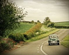 {oh give me a long stretch of road, on an overcast day, in a vintage auto...}