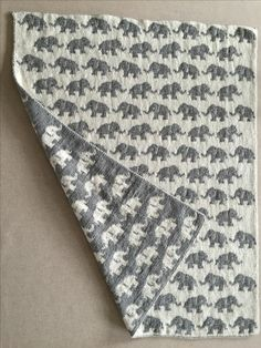 a doubleknitting pattern for a baby blanket with marching elephants Knitting For Kids, Double Knitting, Baby Knitting Patterns, Stitch Patterns, Crochet Patterns, Knitted Baby Blankets, Baby Blanket Crochet, Crochet Baby, Elephant Baby Blanket