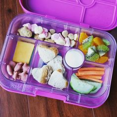 Today's #yumbox❤️ toddler lunch - a mix of strawberry shortcake graham fish crackers, Kashi honey heart cereal, craisins and strawberry marshmallows, kiwi and oranges, carrots, cucumbers and ranch, tuna heart sandwiches, cheddar and goldfish crackers. I like to give her a lot of choices because toddlers are picky and unpredictable  ❤ #toddler #toddlerlunchideas #charley_18months #packedlunch #whatmykidseat #whatmybabyeats #valentinesday #valentinesdaylunch #heartlunch #yumboxlunch #bent...