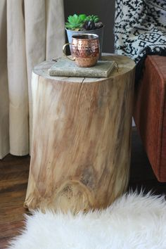 How tо Make а Tree Stump Table Log End Tables, Log Side Table, Tree Stump Side Table, Tree Table, Diy Side Tables, Tree Trunk Coffee Table, West Elm, Wood Stumps, Tree Stumps