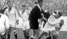 Allan Scherp recieving the consequences of telling Colin Meads to get back on his side of the ruck. New Zealand XV v The Rest match 1966
