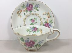 Royal Chelsea Tea Cup And Saucer Multi Colored Flowers And Yellow Accents