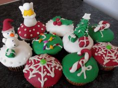 These are my sample christmas cupcakes for this year. Half is plain vanilla sponge and half is moch choc banana, with a layer of buttercream and covered in fondant Holiday Cupcakes, Vanilla Sponge, Whimsical Christmas, Xmas, Christmas Ornaments, Fondant, Cupcakes Decorating, Treats, Holiday Decor