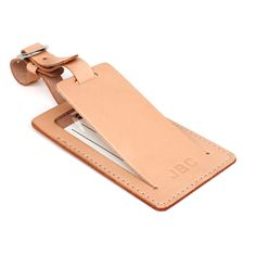 Personalized leather luggage tag with privacy flap handcrafted by Tagsmith