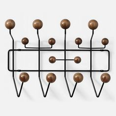 Discover the authentic Eames® Hang-It-All® from Herman Miller, a classic midcentury modern design by Charles and Ray Eames, available in five color combinations. Shop the Eames Hang It All and Eames coat rack. Charles Eames, Hanger Hooks, Coat Hanger, Hangers, Coat Hooks, Wall Hooks, Wall Hanger, Hang It All Vitra, Herman Miller