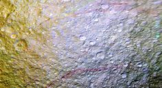 """Unusual Red Arcs Spotted on Icy Saturn Moon"" (Image credit:  NASA/JPL-Caltech/Space Science Institute)"