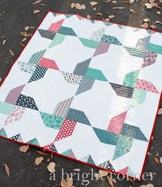 """Jolly Pinwheels quilt created by A Bright Corner - it's a free quilt pattern that uses the Jolly Bar precut! The quilt I designed is called Jolly Pinwheels and I've created a free downloadable (and printable) pattern as well! The finished quilt measures 57"""" x 63."""""""