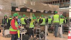 Berlin Brandenburg Airport is put through its paces as hundreds of people test it out ahead of its opening in June.