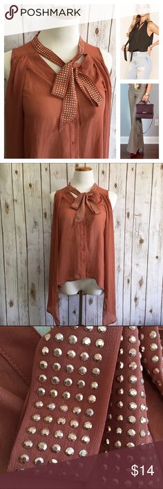 """Love Culture Tie Neck Blouse A light burnt umber color with rose gold studs lining the tie. High low hem with longer sides. Sheer. Pre-loved. Excellent condition. Style inspiration: Wear with distressed high waist jeans for a casual look or high waist dress slacks and pointed toe heels to dress it up.  Size Small Bust 38"""" Length (front) 23-33"""" (back) 29"""" Bundle to receive a discount Love Culture Tops Blouses"""