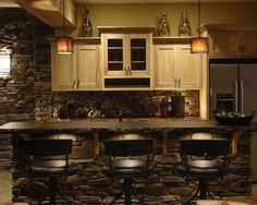 Basement Design, Pictures, Remodel, Decor and Ideas - page 30. Beautiful stone work. Acid stained concrete countertops. Barstools. Love the vases also on top of the cabinets. Very nice
