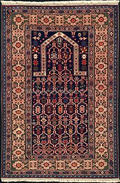 Caucasian Kuba Rug: A Kuba prayer Rug with Kufic border
