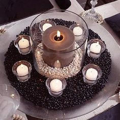 Place pillar candle in a lg glass cylinder, pour dried white beans into cylinder, fill about 2 in deep. place cylinder in a wide glass bowl and pour dried black beans around it. surround cylinder w white candles in glass votive cups Thanksgiving Centerpieces, Candle Centerpieces, Candle Lanterns, Large Pillar Candles, White Candles, Party Table Decorations, Decoration Table, Candle Decorations, Autumn Decorations
