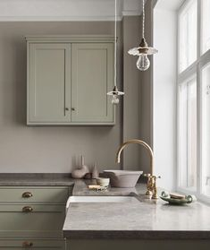 Nordiska Kök - The Classic Shaker kitchen is the natural heart of this beautiful home. Handmade in our carpentry in Gothenburg and handpainted in a pale sage green color, with a limestone countertop. More kitchen inspiration visit www. Classic Kitchen, Cute Kitchen, Shaker Kitchen, New Kitchen, Kitchen Ideas, Kitchen Sink, Awesome Kitchen, Kitchen Soffit, Kitchen Cabinets