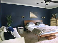 Dark blue wall and incredible platform bed. Paint is Starless Night by Behr