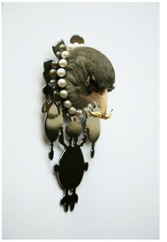 Kelly McCallum, Lady Willamina Cartwright, 2010.  Taxidermy bird, sterling silver, 18ct gold plate, Black rhodium plate, pearls  Saatchi Gallery.