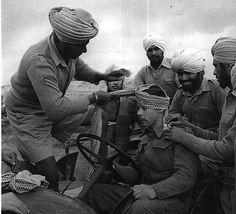 Sikh In World War Tying a turban To another Soldier