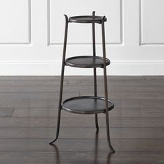 Handcrafted of aluminum and iron, the Lulu accent table makes the most of its petite stature, stacking three round rimmed  shelves for maximum surface area.  HandcraftedIron frame with antique brass finishSpun aluminum tabletops with epoxy coating and food-safe lacquer finishProtect from heat and liquidsDust with soft, dry clothMade in India.