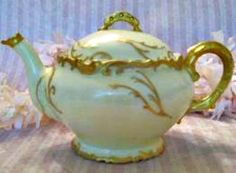 The Gilt work on this exquisite Limoges     Tea pot makes it a treasure indeed.