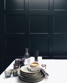 Still life on the table | interior styling | black panelled wall | photo @curatedisplay Instagram | interior stylist Tiffany Grant-Riley