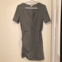 A va-va-voom sort of dress! Zara Trafaluc dress. Fits tightly! It's a great going out dress since it really hugs your curves and has a low v neck! Ruched on one side. Green and black heathered. Pristine condition. Zara Dresses Mini