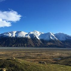 M A J E S T I C mountains | standing atop Edoras over looking my new kingdom that I claimed as my own. Such stunning scenery here in New Zealand. So many mountains. So much mountain love! #Edoras #mountaingirls #embracewinter