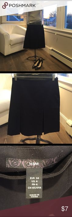 Black H & M pleated skirt I am 5'4 and the skirt lands right above knee. Two large pleats in the front, none in the back. I wore this skirt only a few times--great condition H&M Skirts A-Line or Full