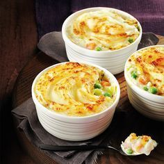 Our mini fish and vegetable pies feature creamy sauce, mild fish and fluffy mashed potatoes. For a twist, substitute sweet potatoes for the russets! Photo by Maya Visnyei. Best Fish Recipes, Seafood Recipes, Cooking Recipes, Favorite Recipes, Cooking Games, Canadian Living Recipes, Fish Casserole, Meals Under 400 Calories, Fish Cakes Recipe
