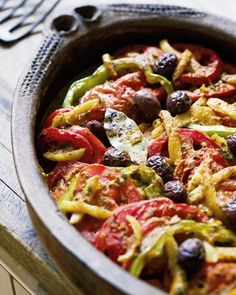 "Choose monkfish or halibut fillets to stew with tomatoes, olives, peppers, preserved lemons, and a rich spice blend of toasted cumin, paprika, and hot pepper. This recipe is from Paula Wolfert's cookbook ""Mediterranean Clay Pot Cooking."""