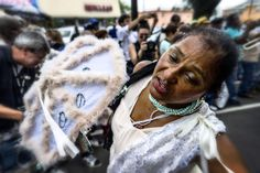 Dancing and celebrating. Jazz funeral. New Orleans.